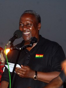 President John Mahama addressing an audience using his iPad
